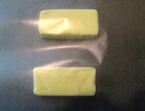 Butter with wax paper on top